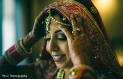 Lovely Indian bride getting her wedding veil on.