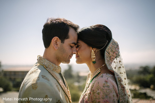 Indian newlywed couple standing together.