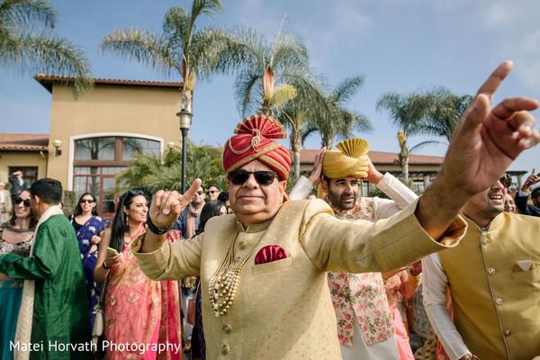 Maharani's father having fun during the baraat.