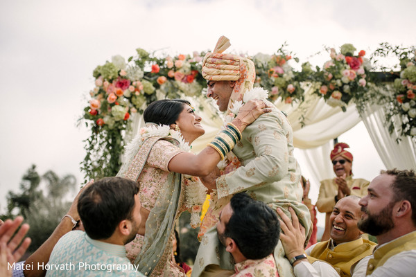 Lovely Indian couple about to kiss in their wedding ceremony.