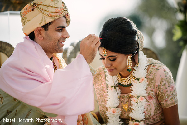 Sindoor is applied to the bride.