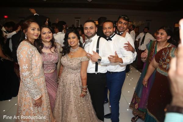 Joyful Indian wedding reception capture.