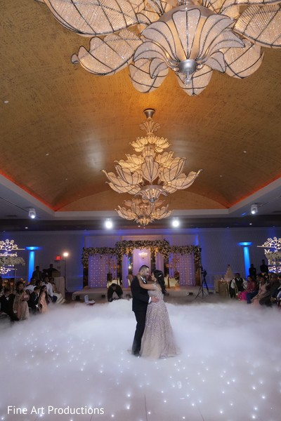 A stunning moment between the Indian newlyweds at the reception.
