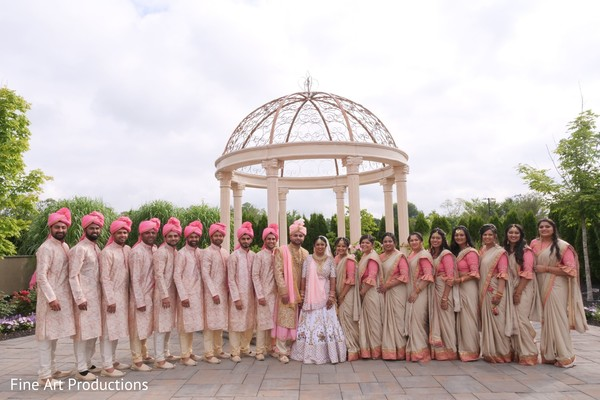 Groomsmen and bridesmaids posing with the Indian couple.