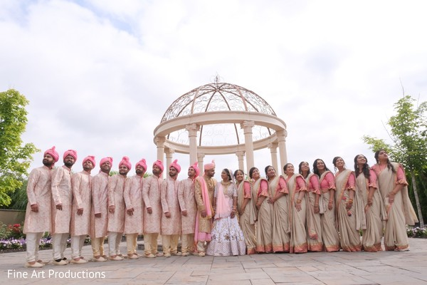 Groomsmen rocking the ceremonial peach sherwani.