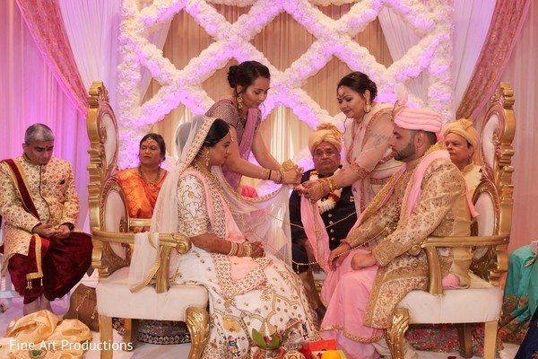 Maharani wearing the ivory bridal saree during the ceremony.