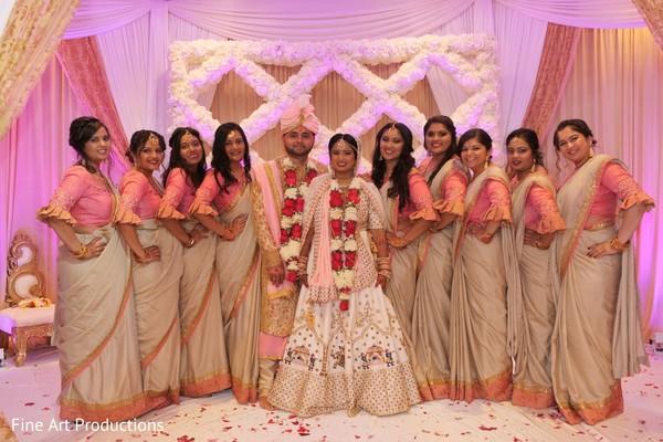 Lovely Indian bridesmaids posing with the Raja and Maharani.