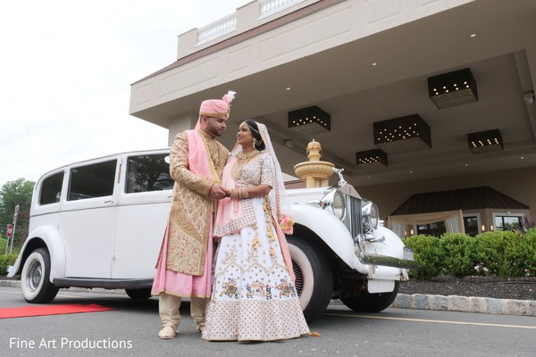 Indian groom and Maharani posing outside the Indian wedding venue.