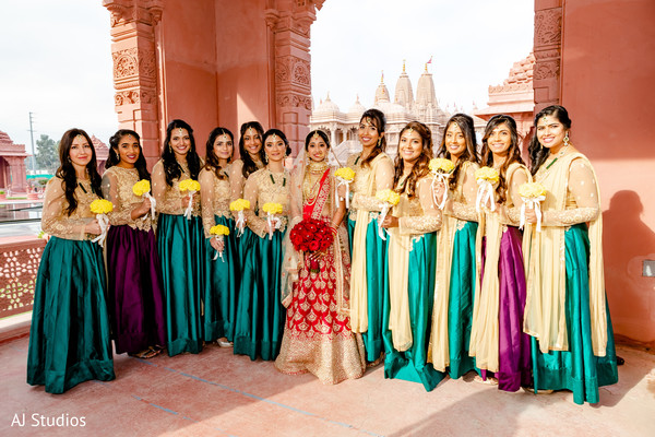 Indian bride and bridesmaids posing with their ceremony outfits
