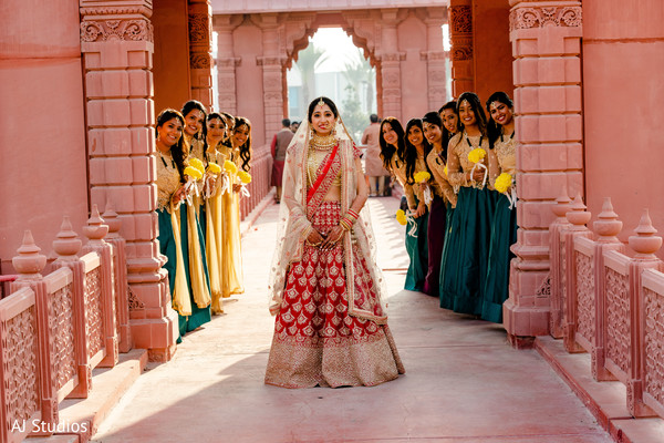 Indian bride posing with her bridesmaids