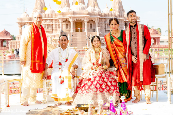Indian bride posing with family