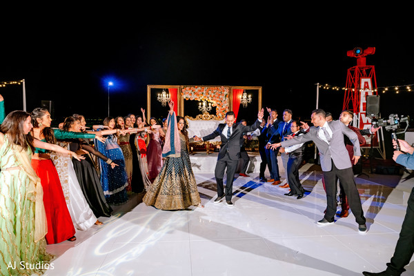 Indian bride and groom dancing at their reception party