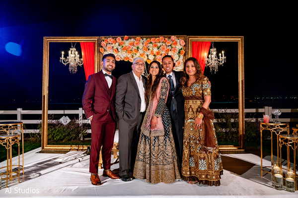Indian couple posing with bride's family