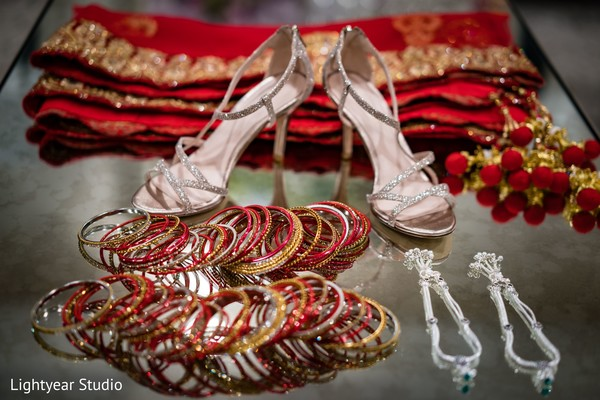 Indian bride's bangles, silver jewelry, shoes, and burgundy saree.