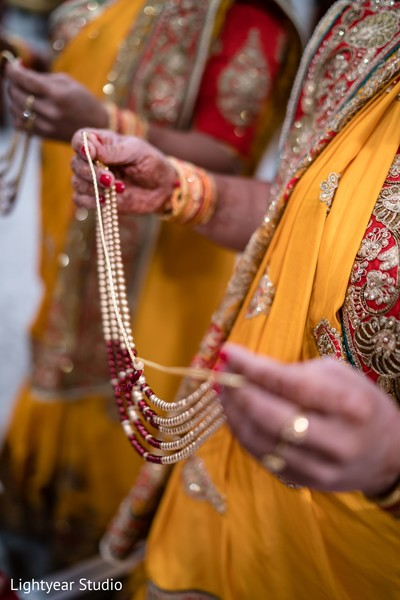 Indian bride's golden jewelry details.