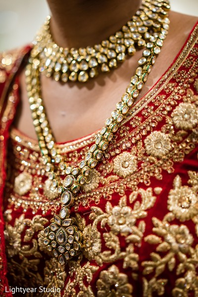 Indian bride's golden jewelry design details.