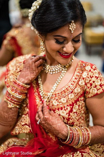 Maharani rocking the red and gold bridal saree and jewelry.