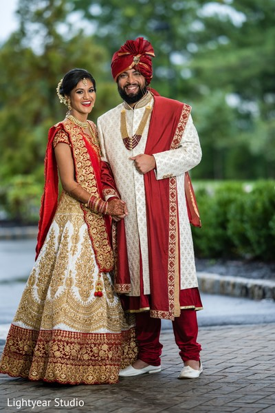 Indian couple wearing the traditional Indian ceremonial attires.