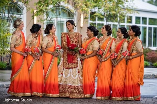 Maharanis wearing orange sherbet sarees during the photoshoot.
