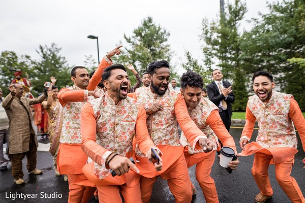 Indian groomsmen having a terrific time during Baraat.