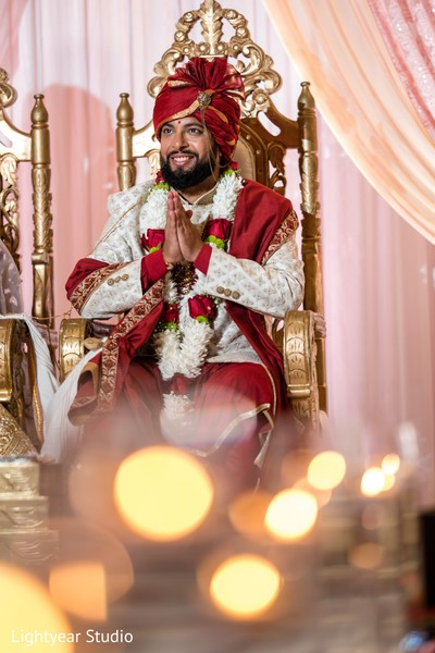 Indian groom having a spiritual moment during the ceremony.