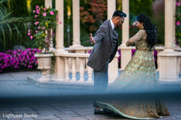 Maharani wearing the reception light teal gown during pictures.