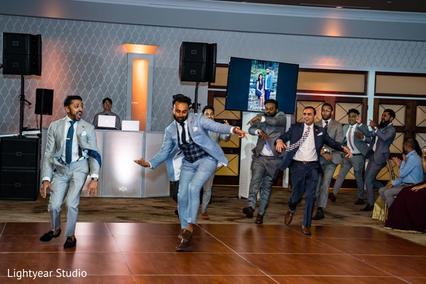 Indian groomsmen having a great time during the choreographies.