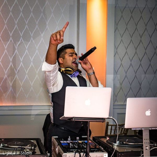 The DJ hyping the Indian wedding guests.