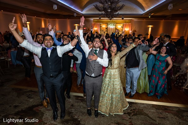 Indian newlyweds celebrating with their loved ones.