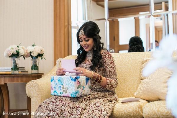 Sweet Indian bride getting grooms present.