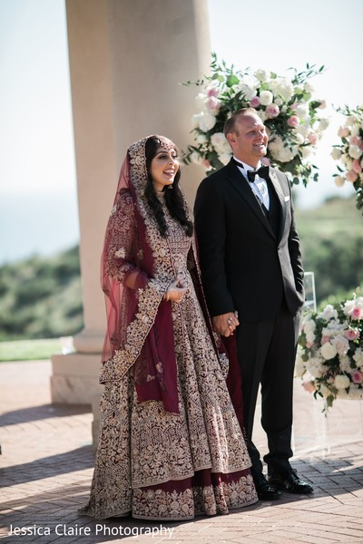 Indian couple on their Indian wedding ceremony outfits.