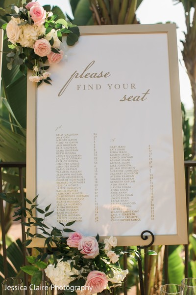 Golden and white Indian wedding seating chart signage.