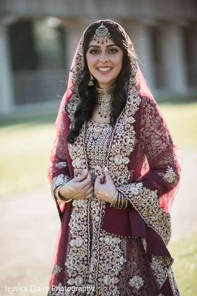 Golden and burgundy Indian bridal ceremony outfit.