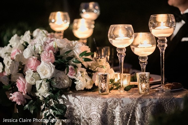 Indian wedding candle lights decoration for table.