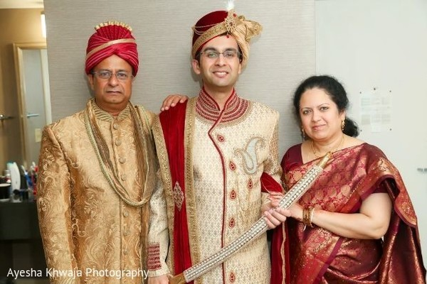 Indian groom with relatives on their wedding ceremony outfits.