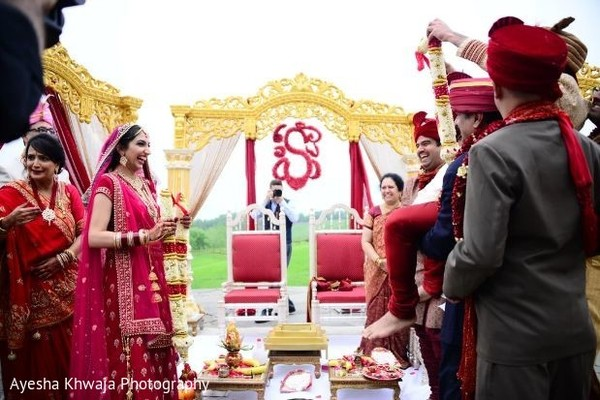Take a look at this traditional south Indian wedding jaimala ritual.