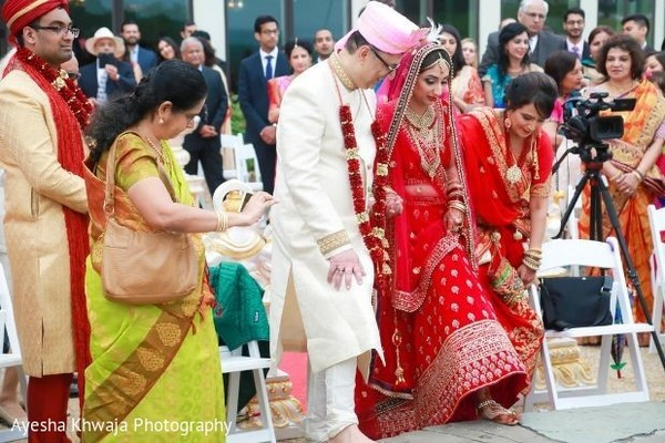 Indian bride stepping into mandap.