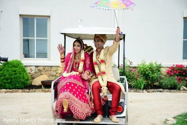 Indian couple leaving ceremony.