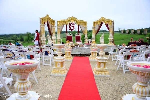 Indian wedding ceremony white, red and golden decorations.