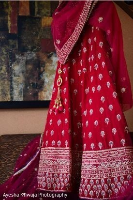 Red and golden maharanis wedding ceremony lehenga.