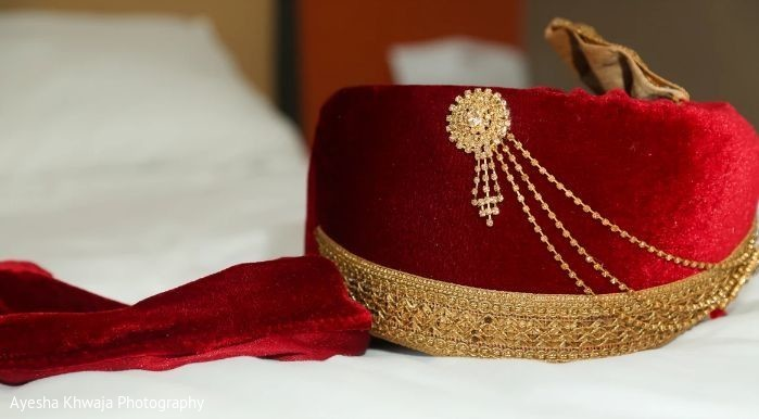 Golden and red Indian grooms ceremony turban.