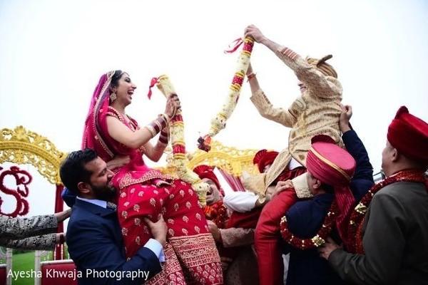 Indian couple at jaimala rituals.