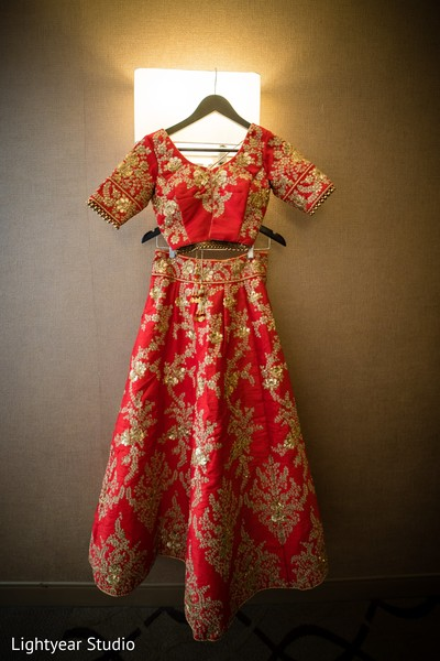 Red lengha with golden details.