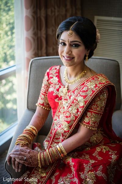 Indian bride in wedding attire.