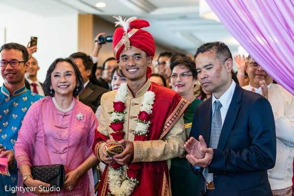 Indian groom with his Indian parents during his Indian wedding.