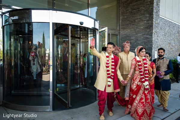 Maharani in red lengha with her Indian groom in golden sherwarni.
