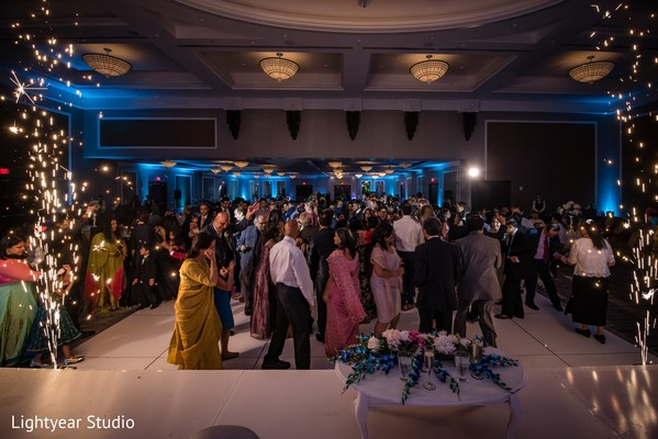 Indian wedding guests having fun in reception party.