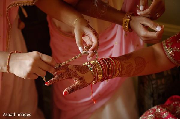 Maharanis ceremony hands jewelry.