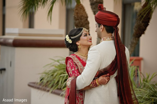 Indian bride and groom first look photo.