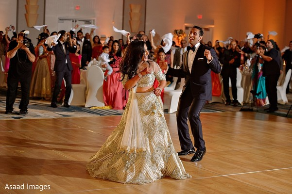 Indian couple having an up beat dance at reception party.
